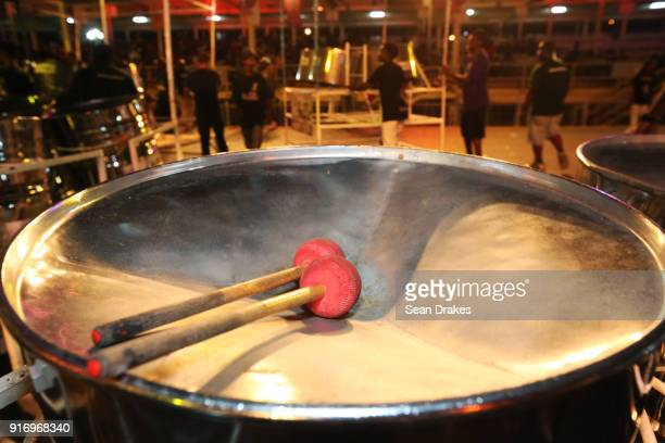 Drumsticks are seen on top of the drum before members the perform of the Caribbean Airlines Skiffle Steel Orchestra during the Panorama Finals...