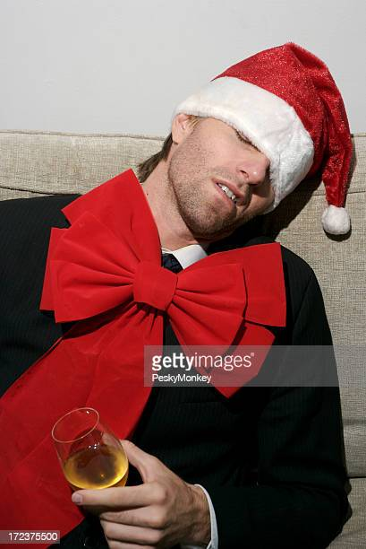Drunk Businessman in Santa Hat and Holiday Red Bow Tie