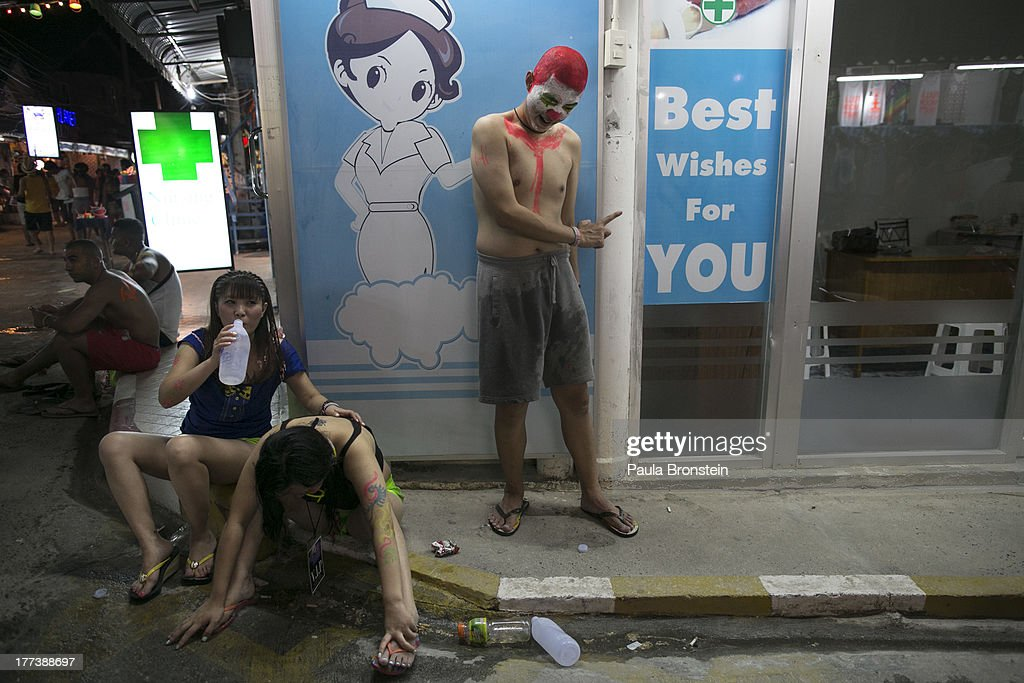 Drunk Chinese partiers try and recover outside a medical clinic just off the party beach of Haad Rin on August 22, 2013 in Koh Phangan, Thailand. Thousands of people from around the world pack the Haad Rin beach enjoying the cheap liquor, drugs engaging in an all night affair. The full moon party started in late 1988 and has become one of the biggest tourist attractions for young backpackers in love with the all night beach party. It is also a huge money making venture for locals both on Koh Phangan and Koh Samui.