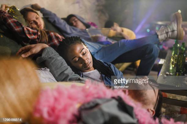 drunk friends fell asleep after party at home. - after party stock pictures, royalty-free photos & images