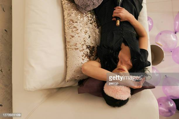 drunk girl taking a nap after her birthday party - after party stock pictures, royalty-free photos & images