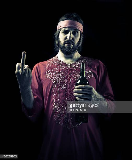 drunk guru giving the middle finger - defeat stock photos and pictures