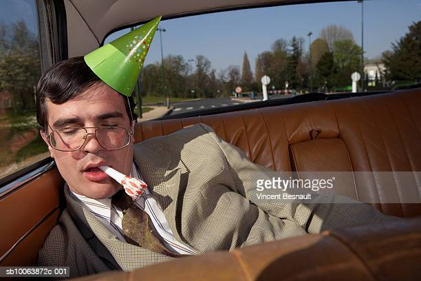 drunk man asleep on back seat of car - drunk stock pictures, royalty-free photos & images