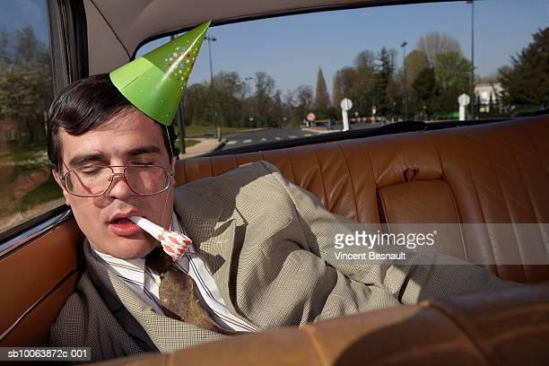 drunk man asleep on back seat of car - betrunken stock-fotos und bilder