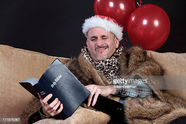 drunk man, bible and red party balloons - christmas after party stock pictures, royalty-free photos & images