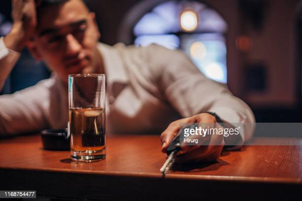 drunk man holding car keys - drinking and driving stock photos and pictures
