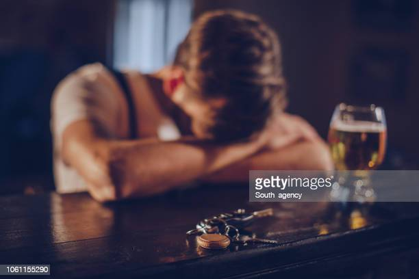 drunk man in pub - liqueur stock pictures, royalty-free photos & images