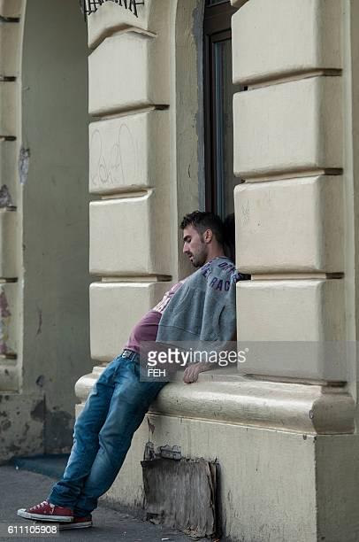 Drunk man sleeping on the street of Prague