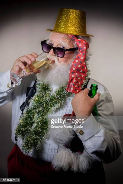 Drunk Santa Claus wearing a gold  party hat