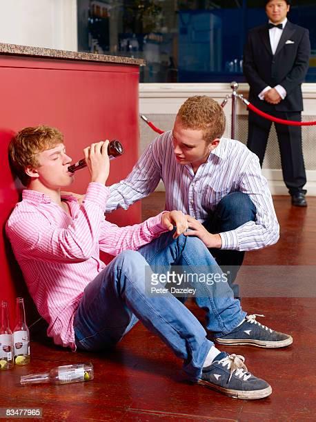 Drunk teenage boy in night club