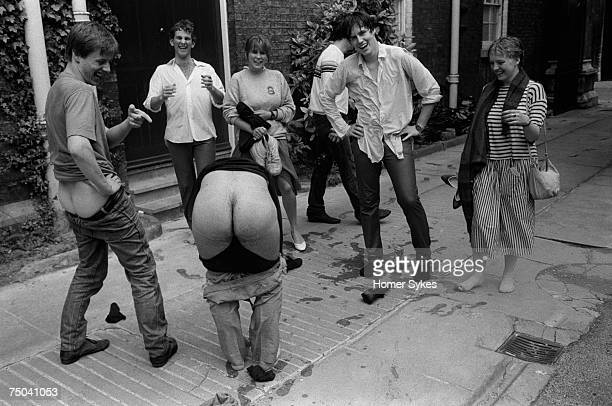 Drunk undergraduate students from Corpus Christie college mooning at the photographer 1983 They have been punting and fallen in the River Cam