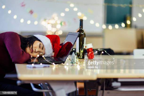 drunk woman sleeping after party on christmas - christmas after party stock pictures, royalty-free photos & images