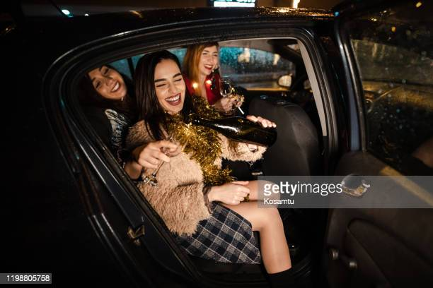 drunk women party at the back-seat of uber - ladies' night stock pictures, royalty-free photos & images