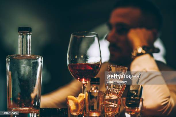 drunk young man in pub - after party man stock pictures, royalty-free photos & images
