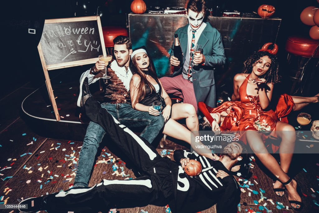Drunk Young People in Costumes Resting after Party : Stock Photo