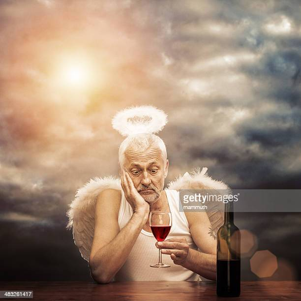 drunken angel - male angel stock photos and pictures