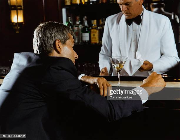 drunken businessman at bar - passed out drunk stock pictures, royalty-free photos & images