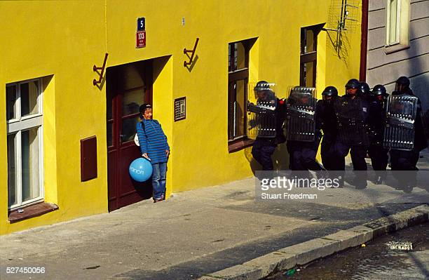 A drunken protester attempts to hide in a doorway as riot police charge demostrators during the protests surrounding the World Bank and International...