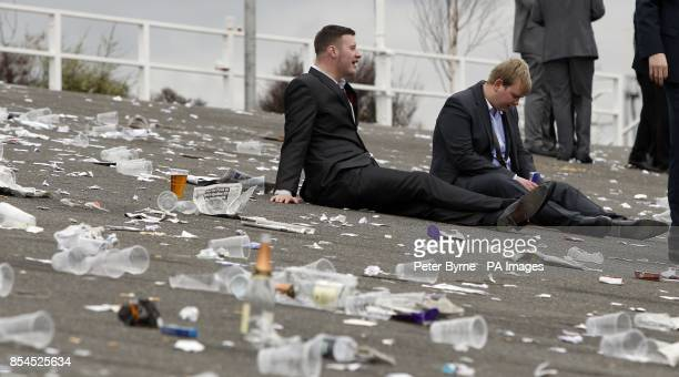 Drunken revelers after the racing finishes during Ladies Day of the Crabbie's Grand National 2014 Festival at Aintree Racecourse Liverpool