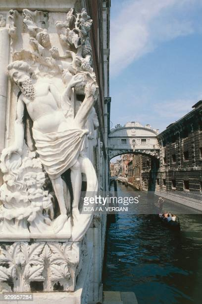 Drunkenness of Noah statue on a corner of Doge's Palace with the Bridge of Sighs in the background Venice Veneto Italy