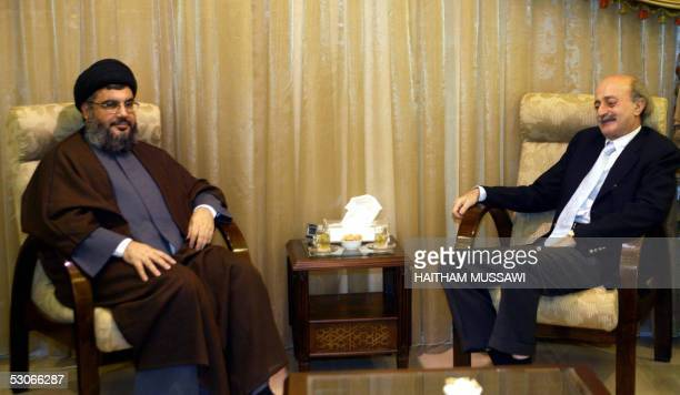 Druze leader and opposition figure Walid Jumblatt meets with Hezbollah Chief Sheikh Hassan Nasrallah in Beirut's southern suburbs 14 June 2005....