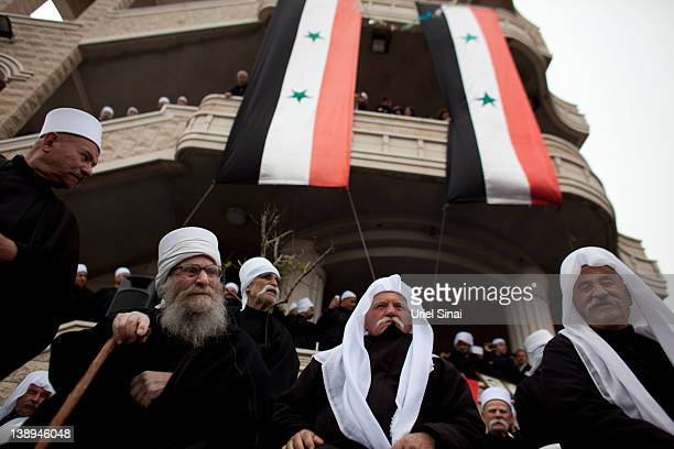 Druze men take part in a rally in the village of Majdel Shams, near the border between Israel and Syria on February 14, 2012 in Golan Heights....