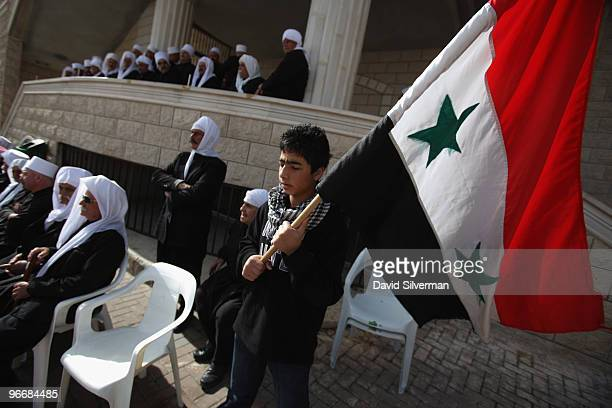 Druze resident of the Golan Heights holds a Syrian flag during a rally in support the Damascus regime on February 14 2010 in Majdal Shams in the...