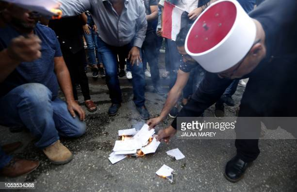 Druze residents of Majdal Shams in the Israeli-annexed Golan Heights set ablaze makeshift ballot papers during a protest on October 19, 2018. - An...