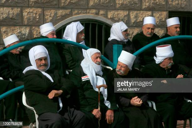 Druze residents of the Golan Heights take part in a rally in the village of Majdal Shams in the Israeli-annexed Golan Heights on February 14 to...