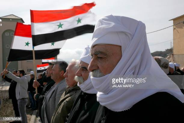 Druze residents of the Golan Heights take part in a rally in the village of Majdal Shams in the Israeliannexed Golan Heights on February 14 to...