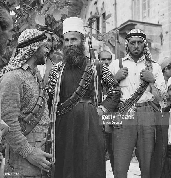 Druze sheikh talks to two members of the rebel army led by Jumblatt in Lebanon in 1958. | Location: Moukhtara, Chouf Mountains, Lebanon.
