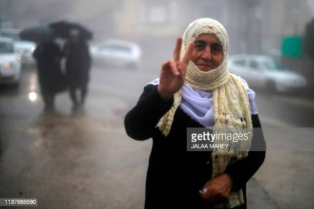 A Druze woman flashes the Vsign for victory during a rally held in the village of Majdal Shams on April 17 2019 to mark Syria's Independence Day in...
