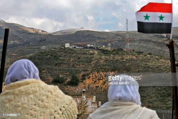 Druze women residing in Majdal Shams in the Israeliannexed Golan heights look to the other side of the border on February 14 during a protest against...