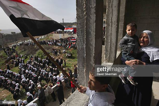 Druze youth waves a Syrian flag as the local Druze communities rallies in support the Damascus regime on February 14 2010 in Majdal Shams in the...
