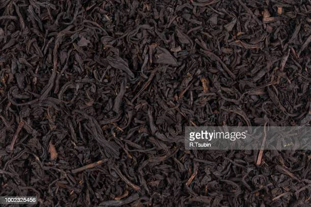 dry black tea leaves close up of texture for background - dried tea leaves stock pictures, royalty-free photos & images