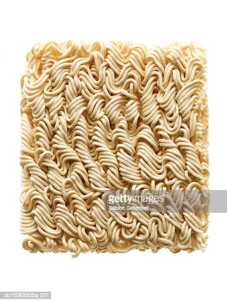 Dry chinese noodles on white background