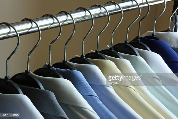 Dry Cleaned Shirts on Hangers on a Rack