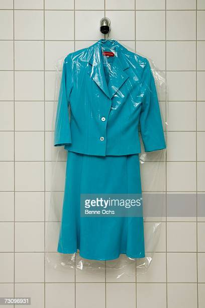 dry cleaned suit hanging in a shower - dry cleaner stock pictures, royalty-free photos & images