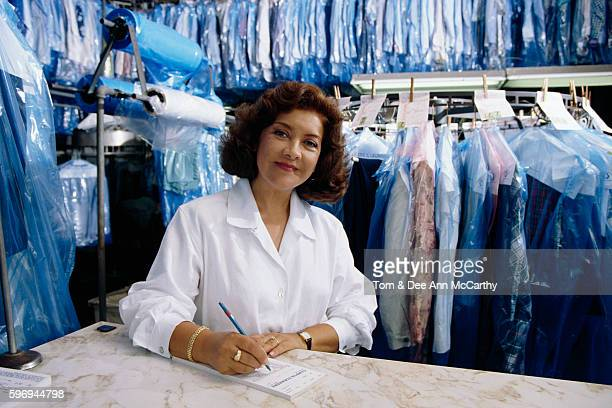 dry cleaner writing up bill - dry cleaner stock pictures, royalty-free photos & images