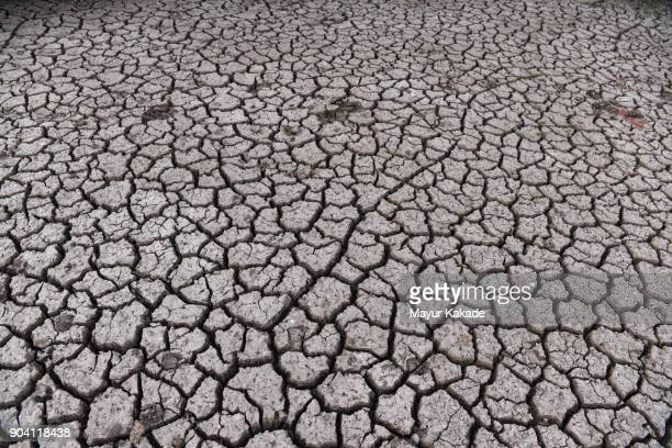 dry cracked bank of rever - drought stock pictures, royalty-free photos & images