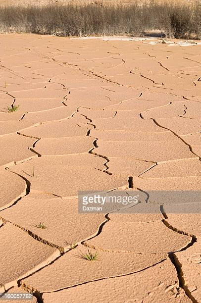 dry cracked claypan during a drought. - scarce stock pictures, royalty-free photos & images