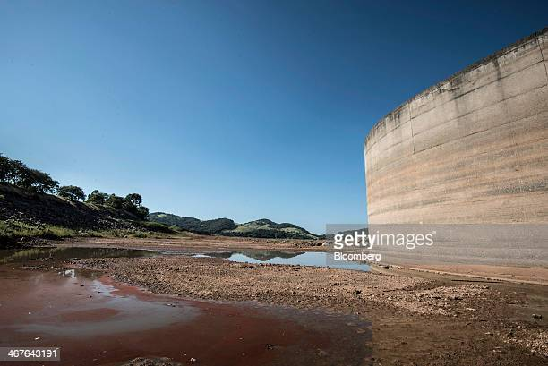 Dry cracked earth is seen where water usually stands at the Jaguari Dam managed by Cia de Saneamento Basico do Estado de Sao Paulo known as Sabesp...