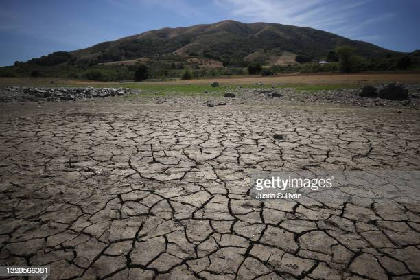 Dry cracked earth is visible as water levels are low at Nicasio Reservoir on May 28, 2021 in Nicasio, California. Marin County is under mandatory...