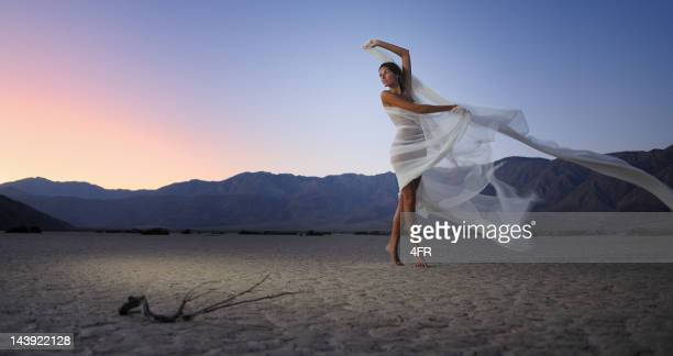 dry desert dancing - lake bed stock photos and pictures