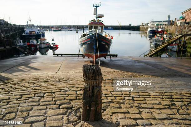 A dry docked fishing boat awaiting repairs sits tied to a post in the harbour in Scarborough UK on Tuesday June 2 2020 The threat of a nodeal Brexit...
