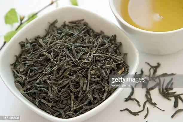 seco hojas de té verde - hoja te verde fotografías e imágenes de stock