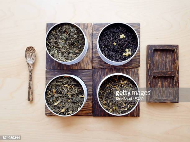 dry herbal tea in the bowl - lemon leaf stock photos and pictures