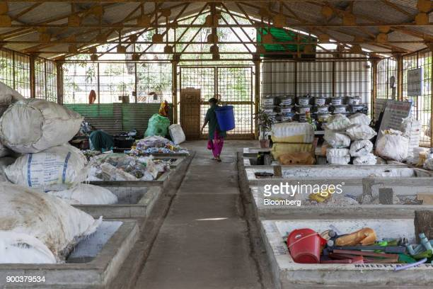 Dry household waste is sorted in a warehouse at a recycling facility operated by Mysuru City Corp in Mysuru Karnataka India on Tuesday Nov 21 2017...