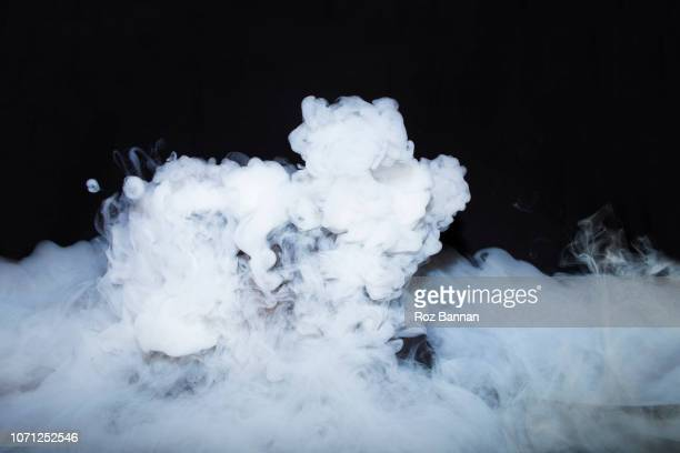 dry ice in a cauldron - nebel stock-fotos und bilder