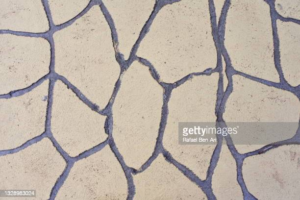 dry land shaped tiled floor - rafael ben ari - fotografias e filmes do acervo
